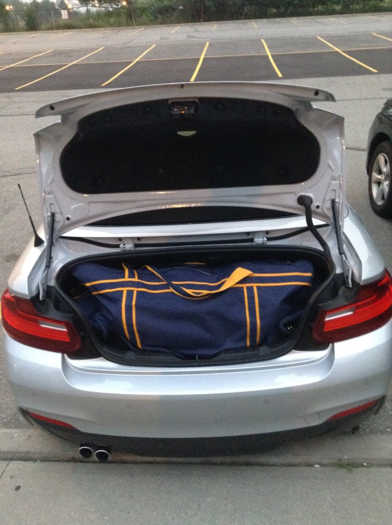 The hockey bag wanted to burst out of the trunk.